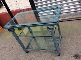 Three metal tables
