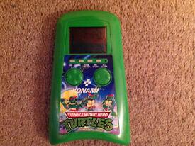 Rare Konami Teenage Mutant Hero Turtles retro handheld game.