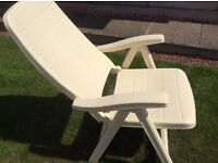Two heavy duty white plastic chairs with up to five positions