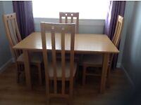 Light Oak extended table and 4 chairs in good condition