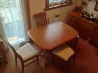 Extending dining room table for sale.