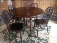 Solid dark wood round table and chairs OFFERS ACCEPTED