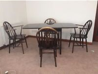 Ercol dark wood dining table and 4 x chairs