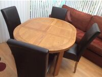 New & Unused, Solid Oak Extending Dining Table & Four Leather Chairs.