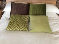 Selection of co-ordinating cushions for bed or sofa.