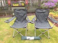 Two folding chairs with cup holders and a small changing tent