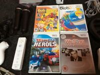 Nintendo Wii with controllers games and Wii sing microphones