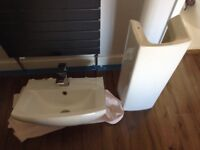 White sink, pedestal and mixer tap
