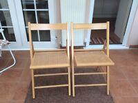 2 wooden folding chairs,