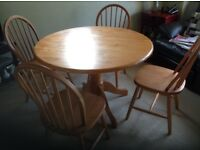 Kitchen table and four chairs in pine.
