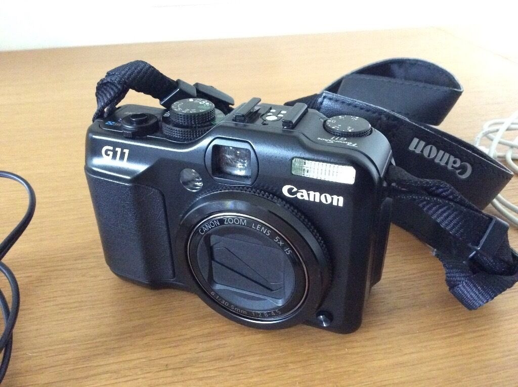 Canon G11in Marston, OxfordshireGumtree - It is in excellent condition. Comes with a 4GB memory card. Battery charger has American plug, great for abroad travel. But can be used with uk plug adaptor