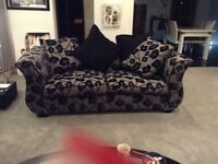 DFS felicity p/back 3S bed sofa With plain black chair and pouffe
