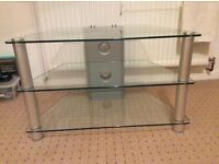 "TV unit. 3 glass shelves. Would fit tv's up to 30"". Immaculate condition"