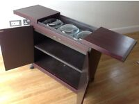 Hostess trolley in good working order. Three glass dishes with lids included.