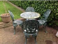 Bistro table and four chair set