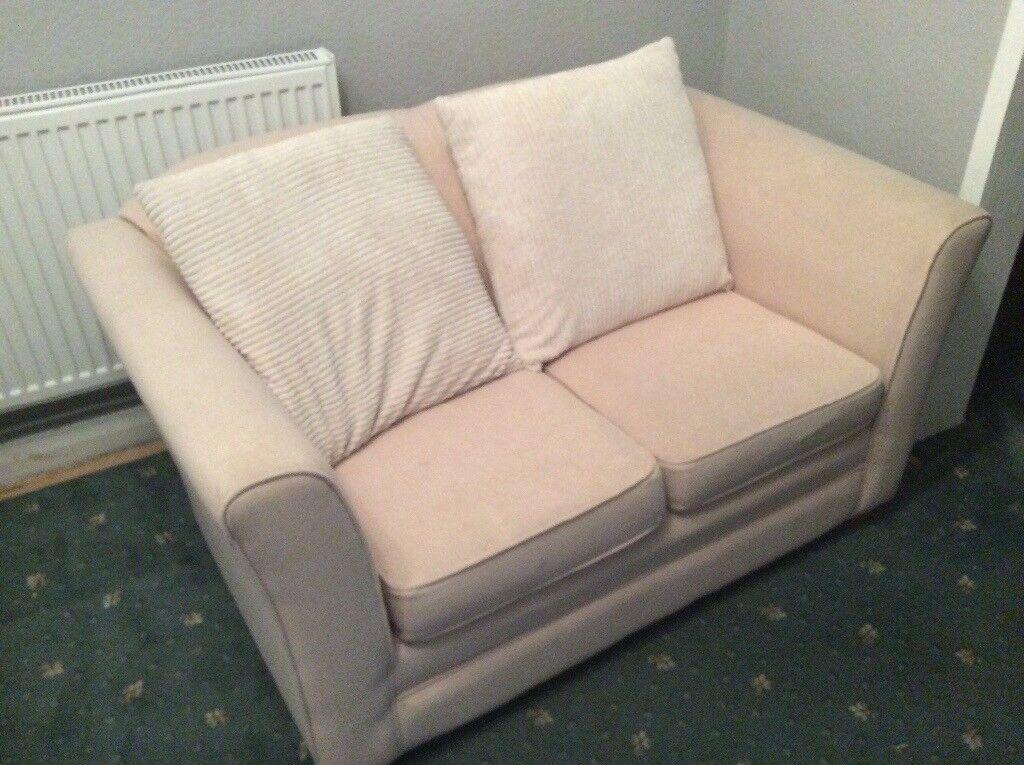 2 seater cream coloured sofa