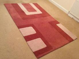 Carpet / Rug. Cream with coral shades. 240cm x 147cm. Excellent condition. £70 Buyer collects.