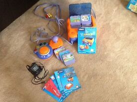 VTech Smile electronic activity set. 5 cartridges with manuals. Joy stick and leads. .