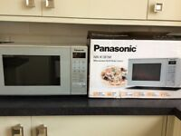 Brand new Panasonic microwave/grill still boxed. Silver finish