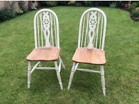 Pair of Old Charm Wheel back dinning chairs. Painted off white then waxed.
