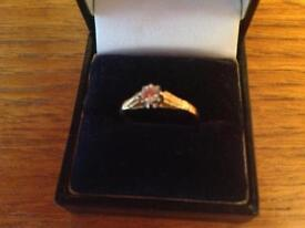 18 Carat Gold Band holding a .20 diamond in really nice condition.