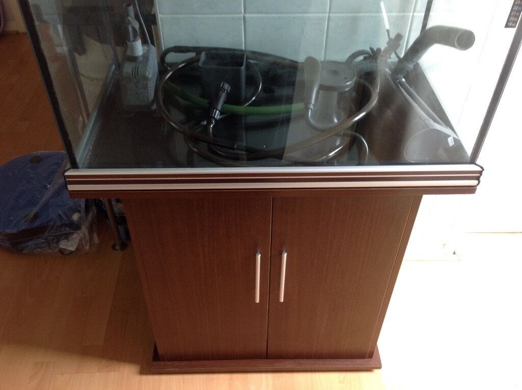 200L Aqua One Fish Tank with Cabinetin Luton, BedfordshireGumtree - 200L Aqua One Fish Tank with Cabinet Here I have a 200L Aqua One fish tank with cabinet. The tank is rectangular in shape. The top and bottom surround is dark wood with aluminium stripes. H 55cm (21.5inches), W 80cm (31.5inches), D 45cm (17.5inches)....
