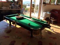 Table top pool table. Suitable for children. Easily stored. Comes with all accessories.