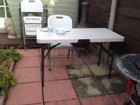 Lifetime white plastic table and 4 chairs. Light weight very strong good quality excellent condition