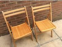 Two Fold away wooden chairs