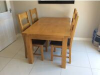 Solid wood table & chairs cost well over a £1000
