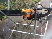 Chainsaw and bench
