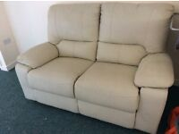 Cream leather look 2 seater sofa matching arm chair. All fully reclining