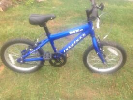 Boys blue MX16 Ridgeback bike, single speed, lightweight aluminium frame. Used but still good cond