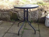 Small glass & metal bistro table