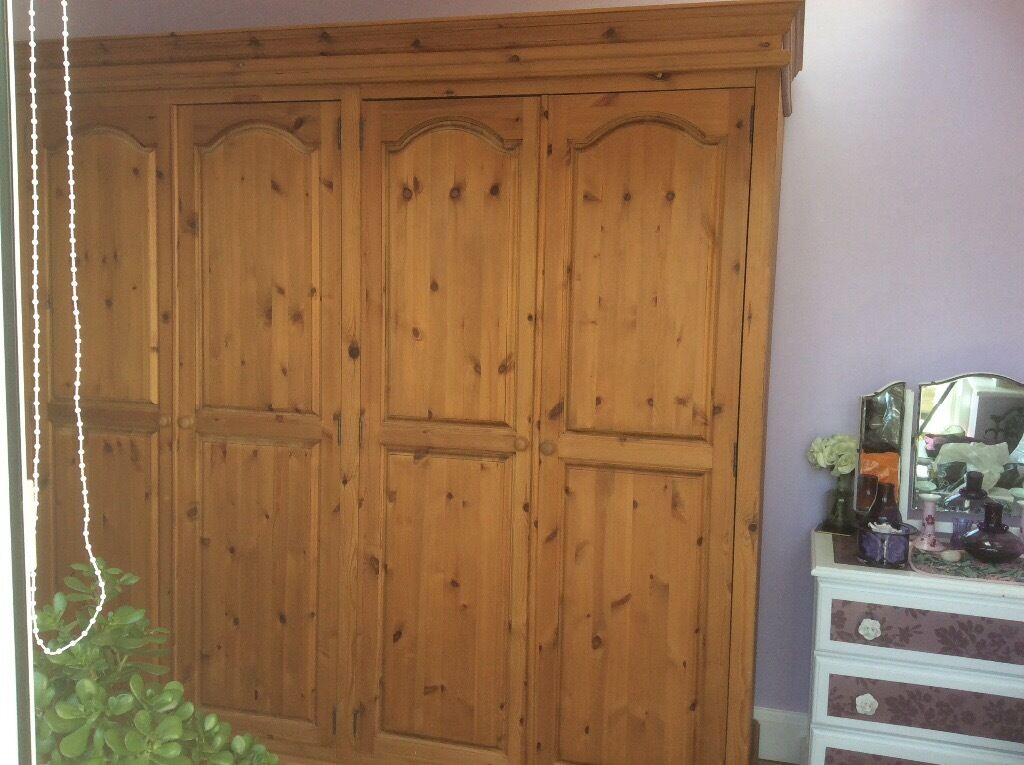 Fabulous 4 door solid pine wardrobe . Excellent condition.3 hanging areas and four roomy shelves