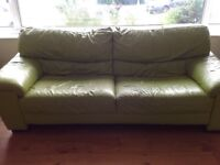 Large green leather sofa