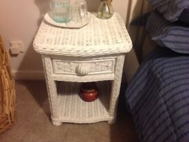 White wicker bedroom chest of drawers and bedside tables