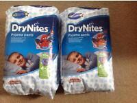 Two unopened packs DryNites 4-7 years