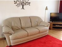 Stressless Chairs with a leather three seater sofa