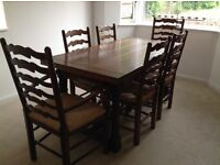 Dining room table, chairs and sideboard in solid wood.