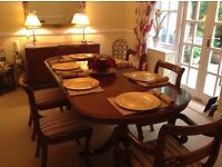 Bradley Table with six chairs and a sideboard in good condition