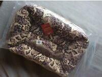 Soft pet bed for small dog or cat. New in pack.