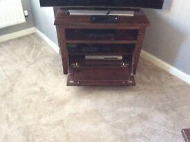 Dark wood tv cabinet
