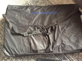 Feel good black massage table with carry case and black fleece cover. Used.