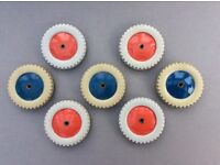 Meccano wheels plastic. Four red and three blue. All with grey tyres