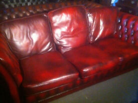 Oxblood red leather Chesterfield sofa