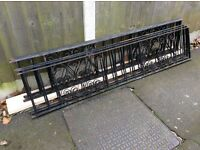 EIGHT PIECES OF DECORATIVE BLACK METAL WALL / FENCE RAILING