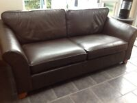 Three seater brown leather sofa and footstool