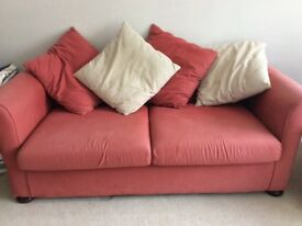 Large brick red sofa bed. Good quality.