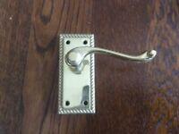 Brass rope edged door handles.